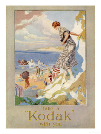 10083019woman-cautiously-descends-a-cliff-path-to-the-beach-clutching-her-precious-kodak-posters